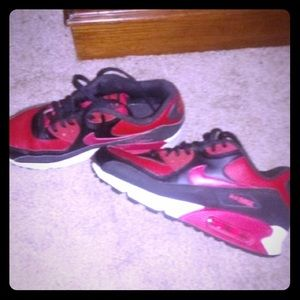 Woman's red and black Nike's